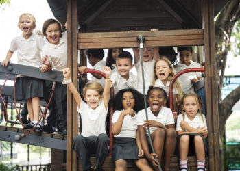 Group of diverse kindergarten students at playground together